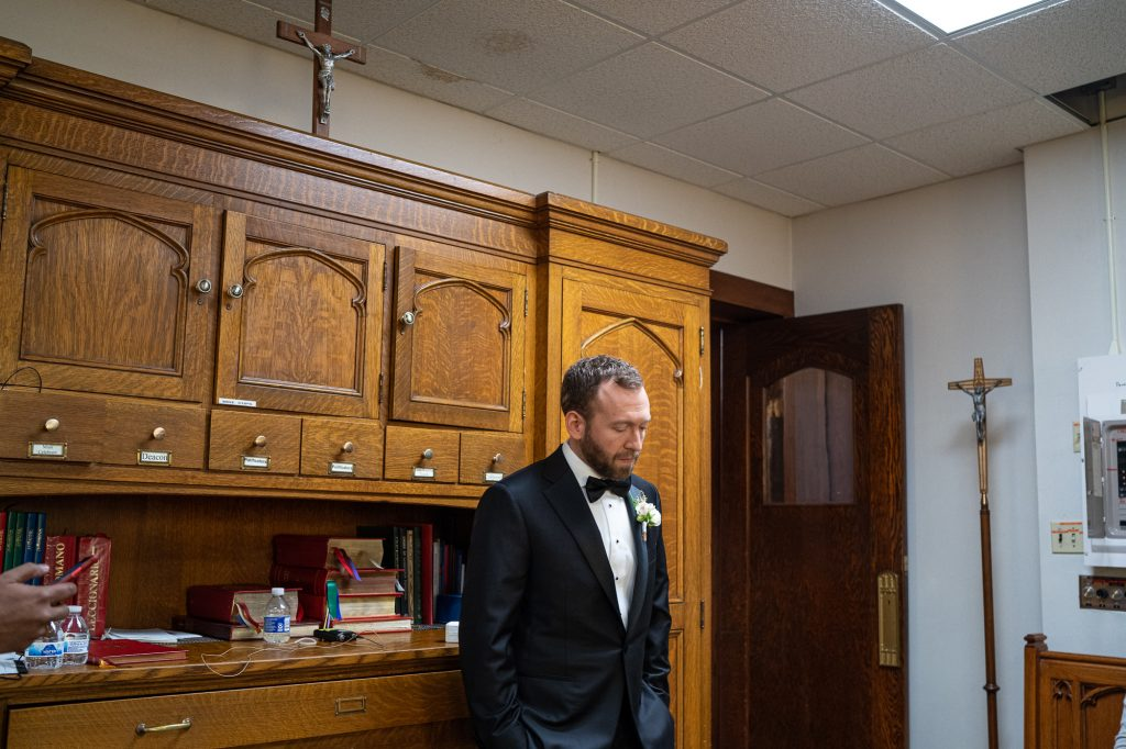 wedding photography wisconsin groom waiting