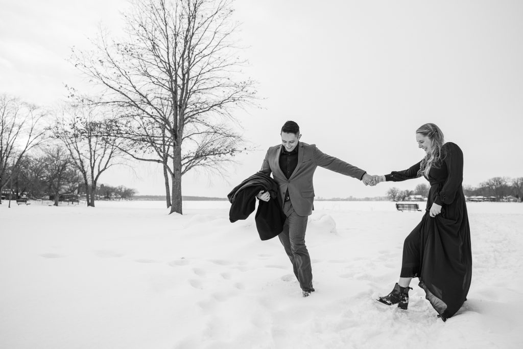 couple walking holding hands snow
