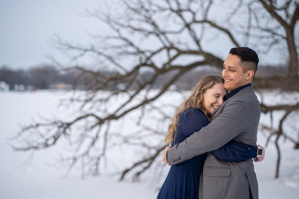 engaged couple hugging