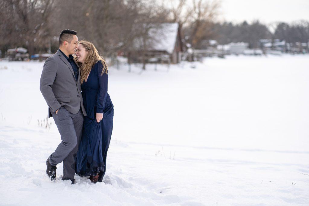 man and woman walking laughing