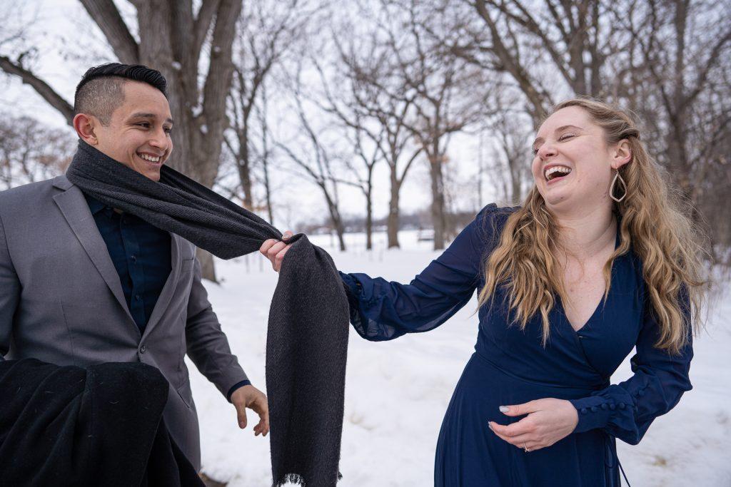 woman pulling man scarf