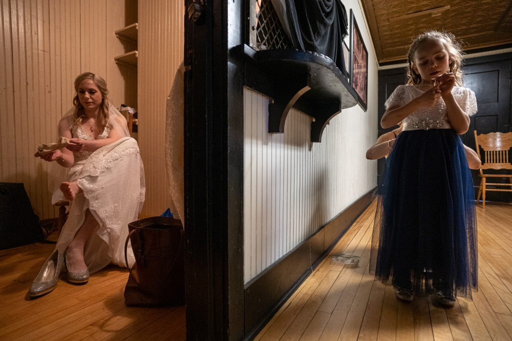 bride and flowergirl getting ready
