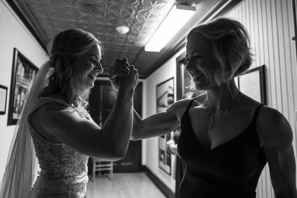 bride and her sister arm wrestling