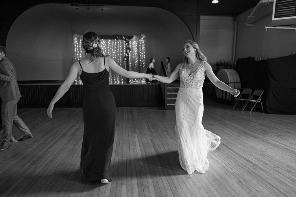 bride dancing with her sister wedding reception