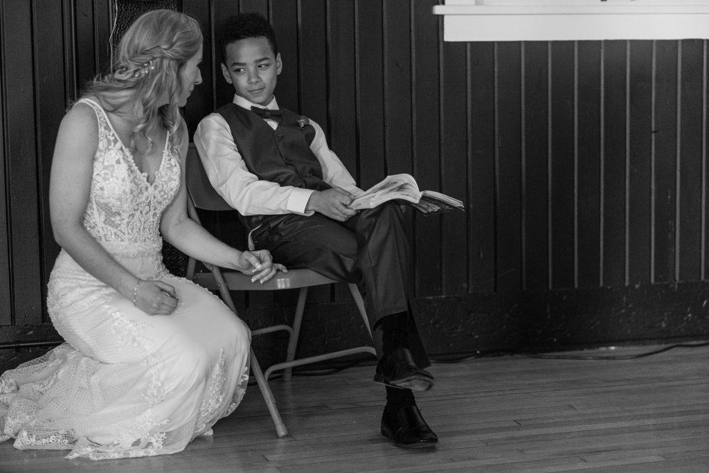 bride talking with a kid wedding reception