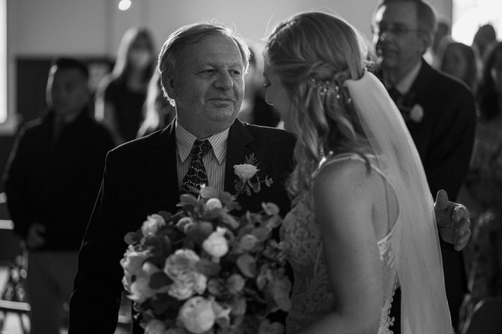 father giving daughter away wedding day