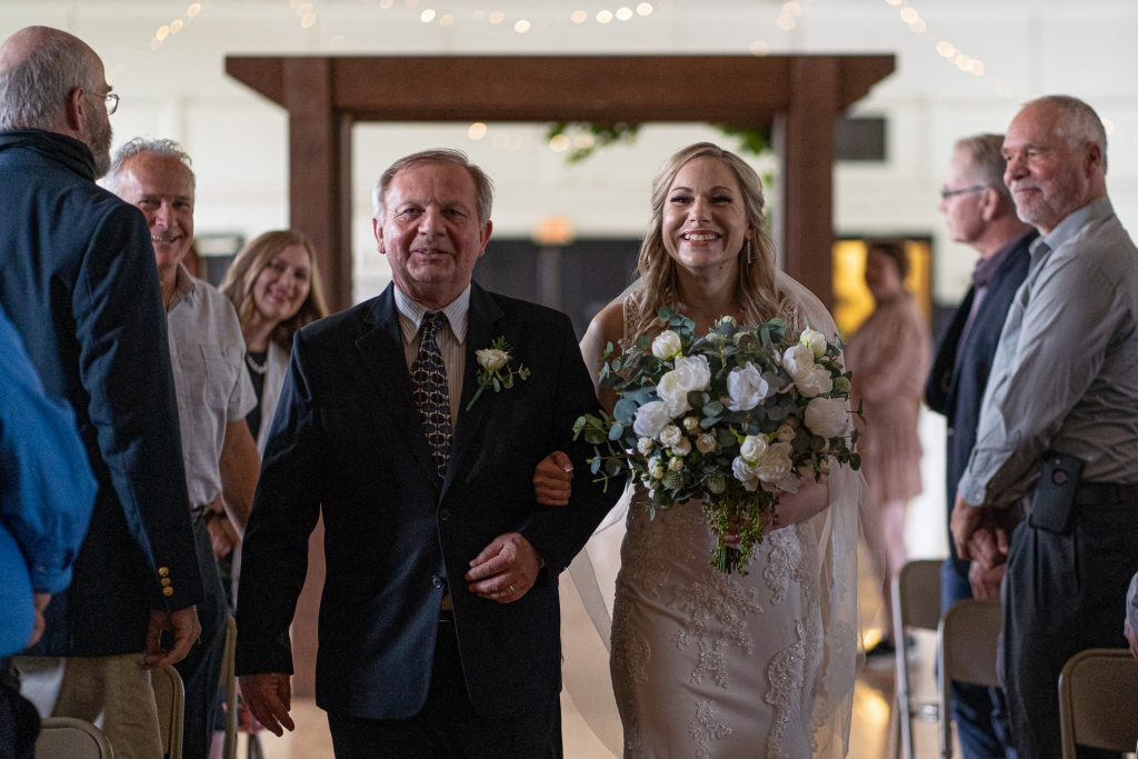 father walking daughter wedding ceremony
