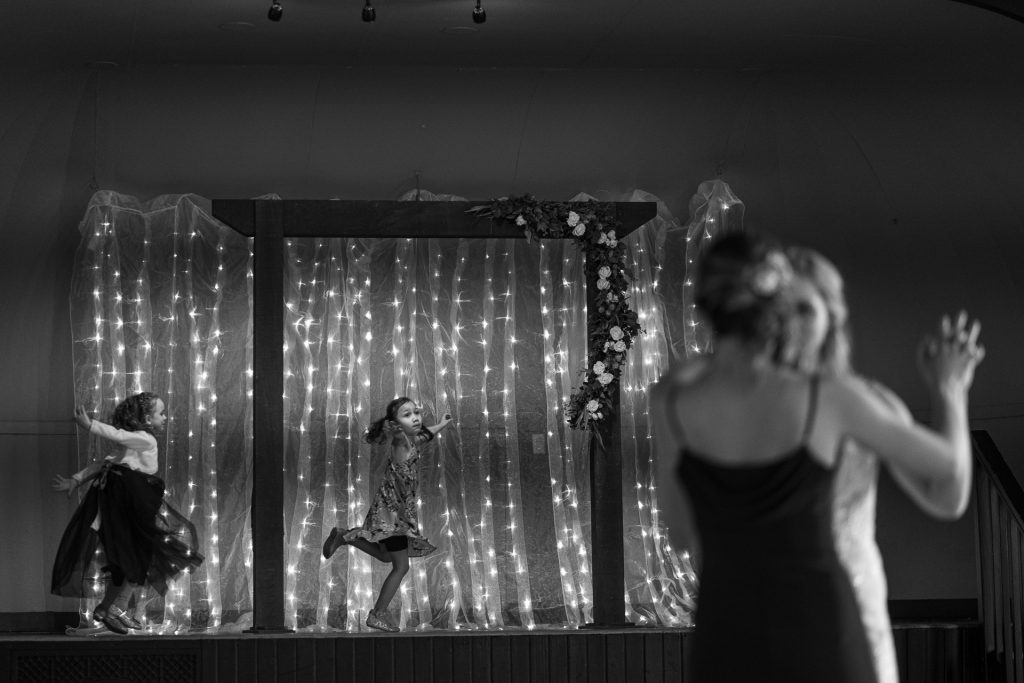 girls dancing during wedding reception