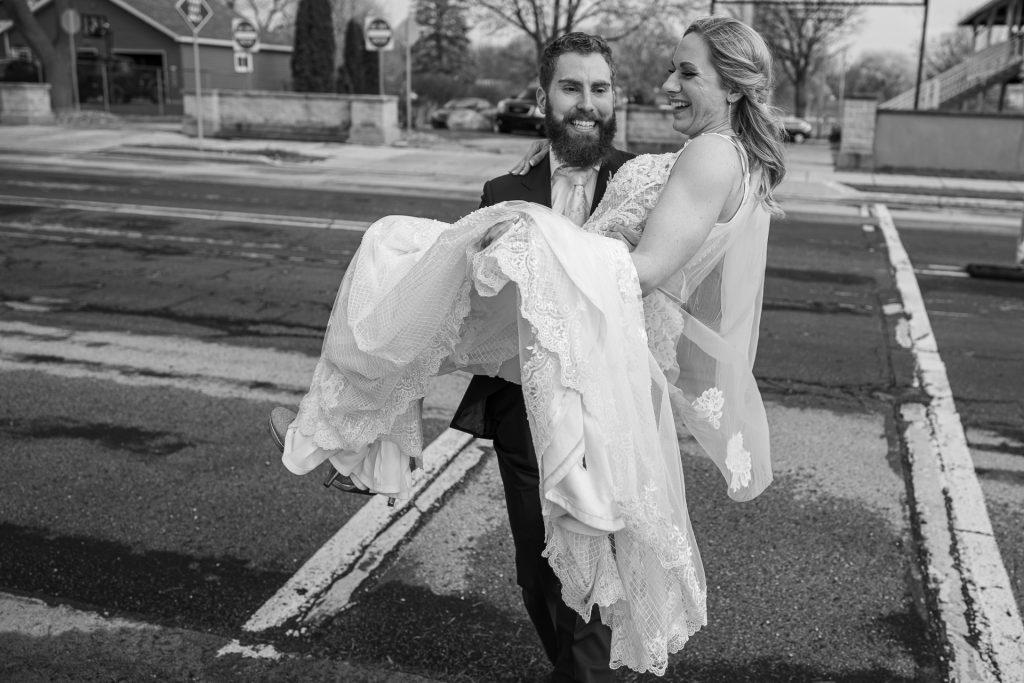 groom carrying bride at Columbus WI