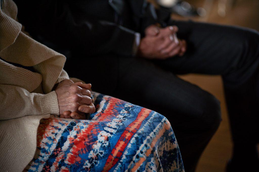 grooms parents praying hands