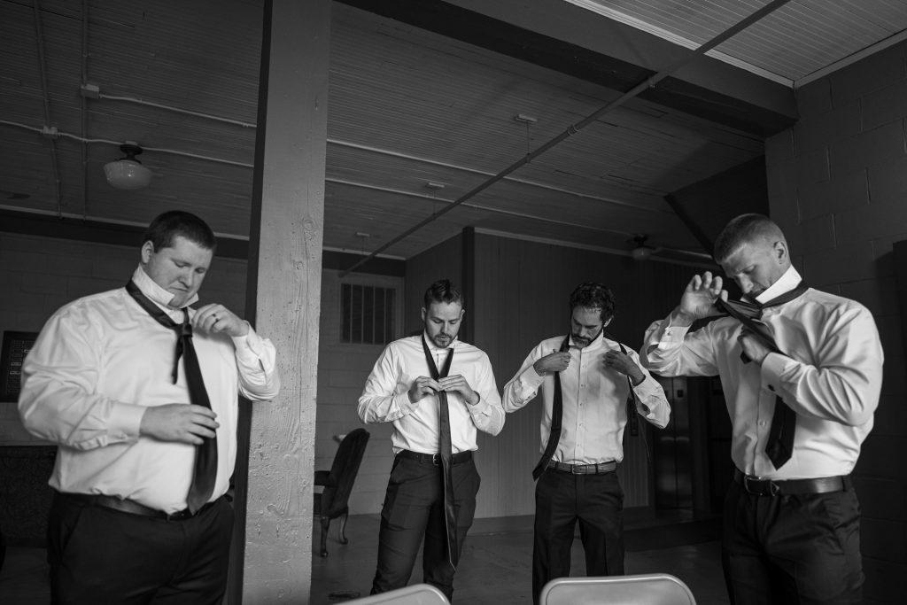 groomsmen struggling with ties