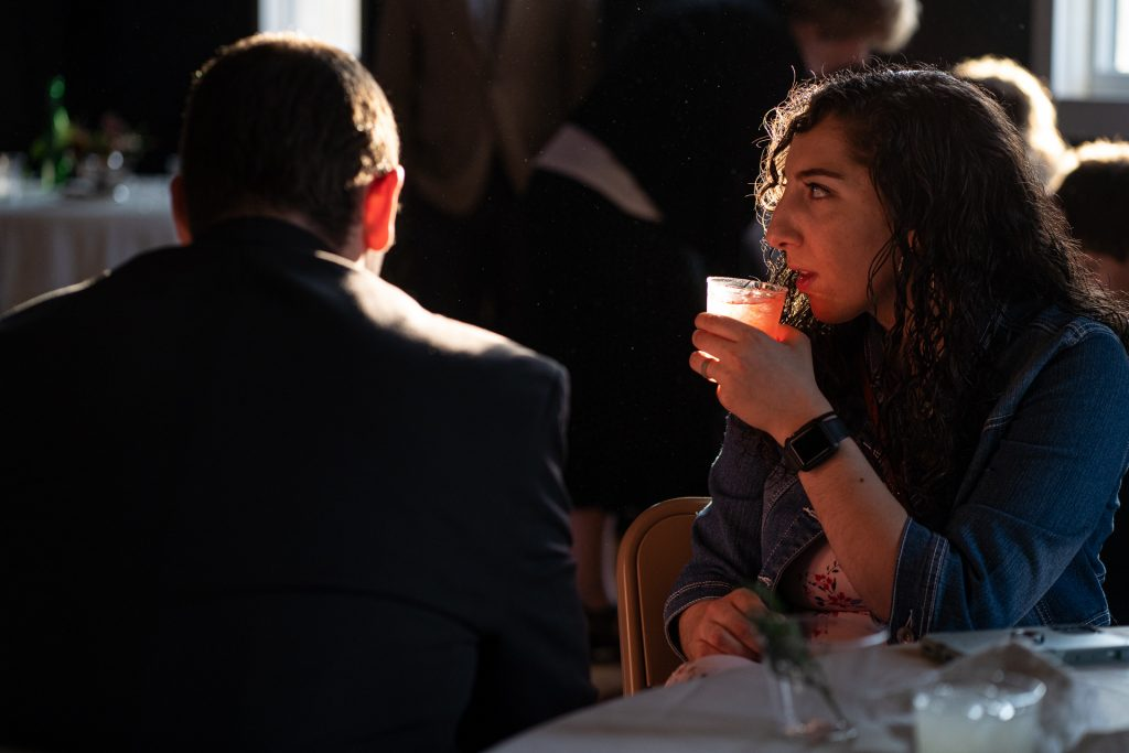 guest drinking with sunset light