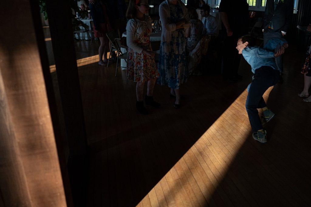 kid running during wedding reception