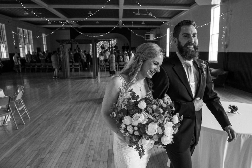 newly weds leaving wedding ceremony