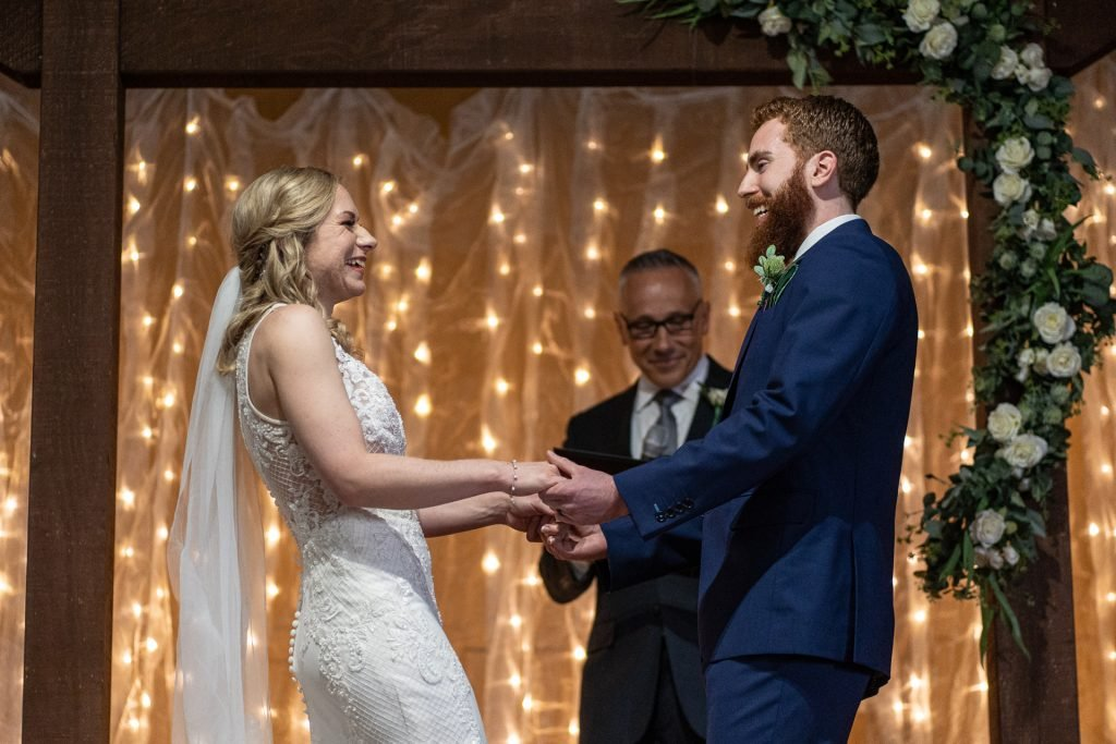 wedding couple holding hands during ceremony