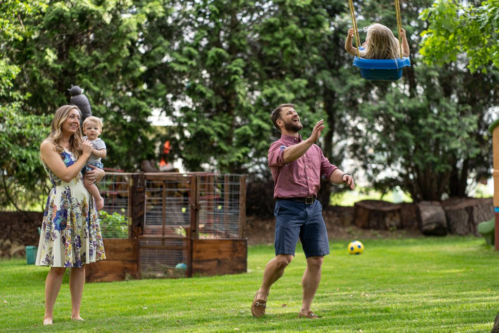 a family and a swing