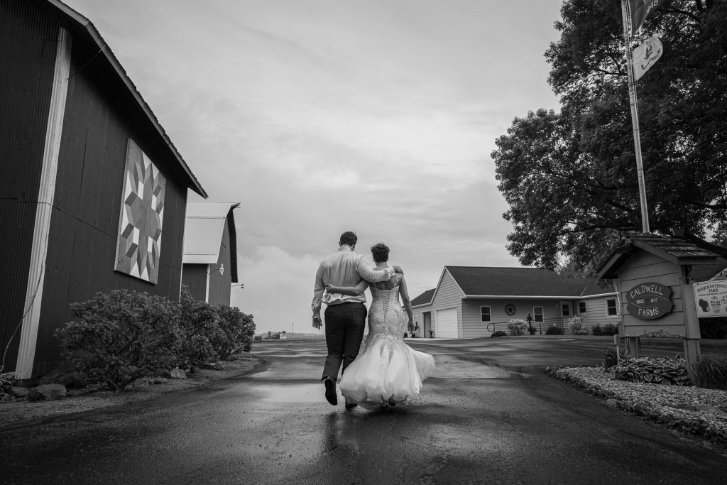 bride and groom with arms around each other shoulders
