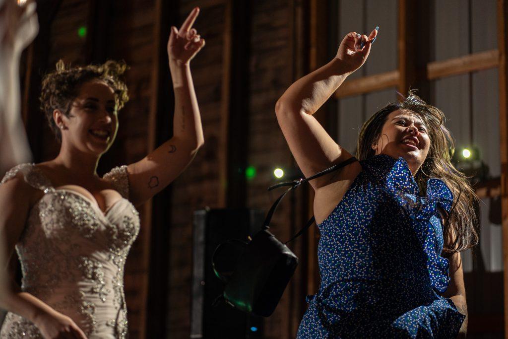 bride dancing with a friend wedding reception