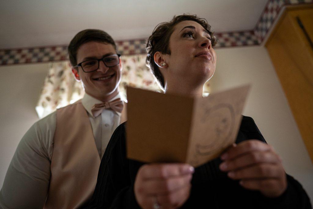 bride reading a card wedding photography