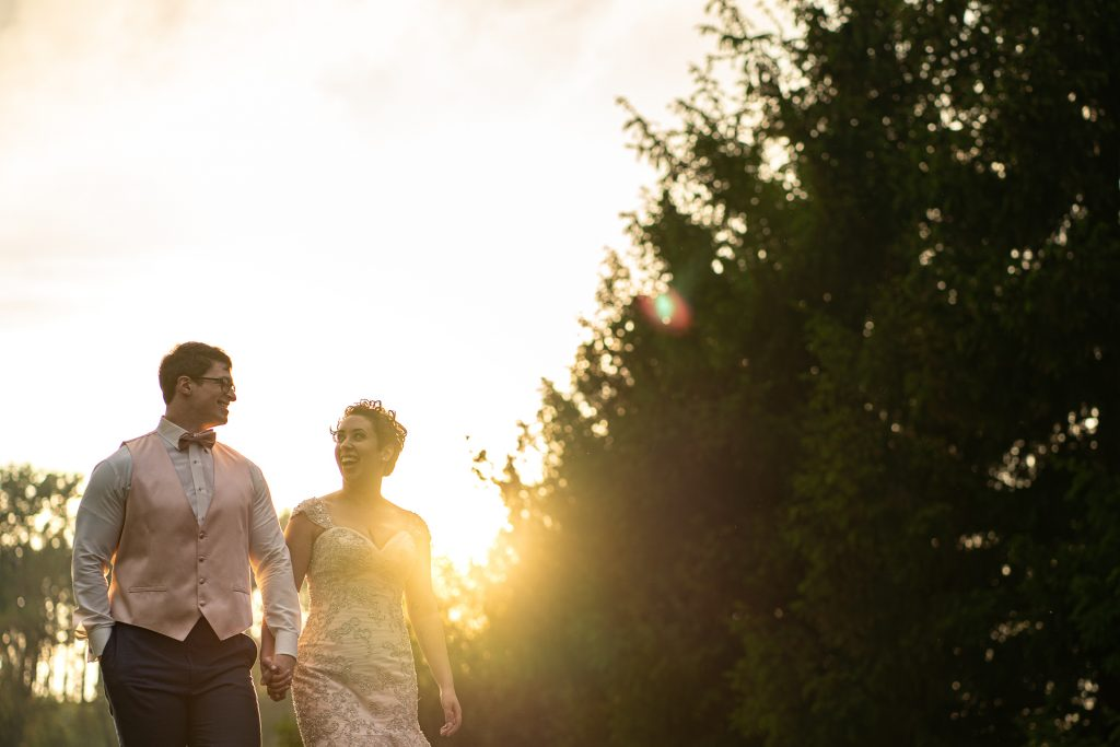 couple holding hands during sunset