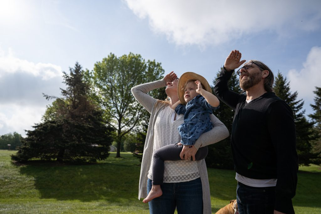 family looking up the sky