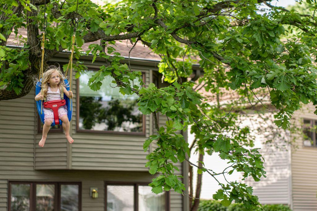 girl flying high on a swing