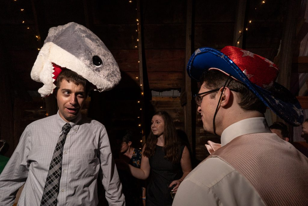 guest and groom with funny hats