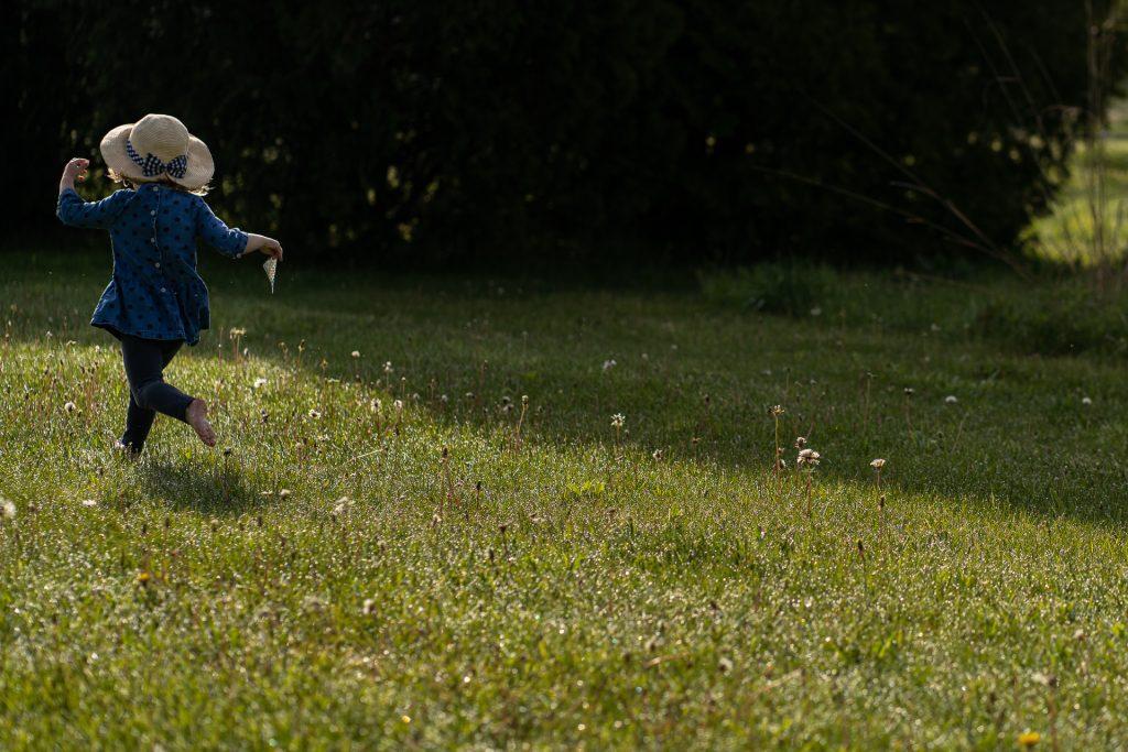 little girl running barefoot