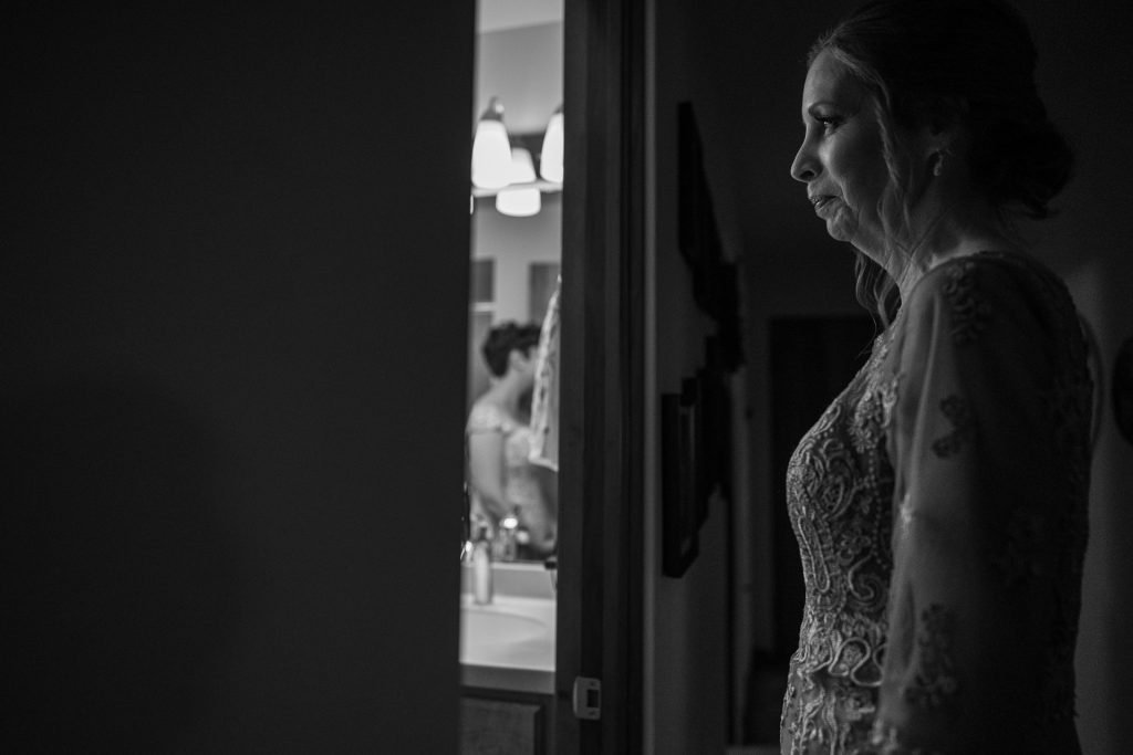 mother pensively looking at her daughter bride