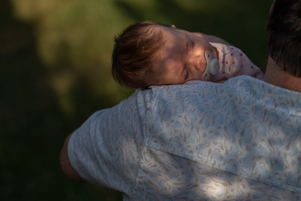 peaceful sleepy baby on grandpas shoulder