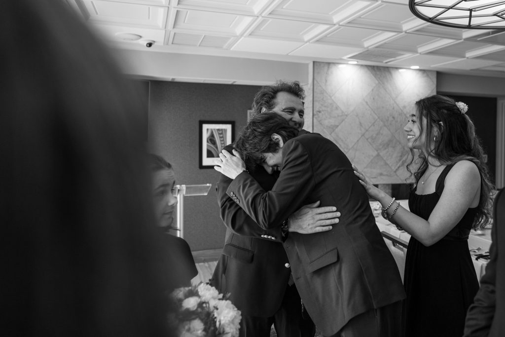 son congratulating his dad for getting married