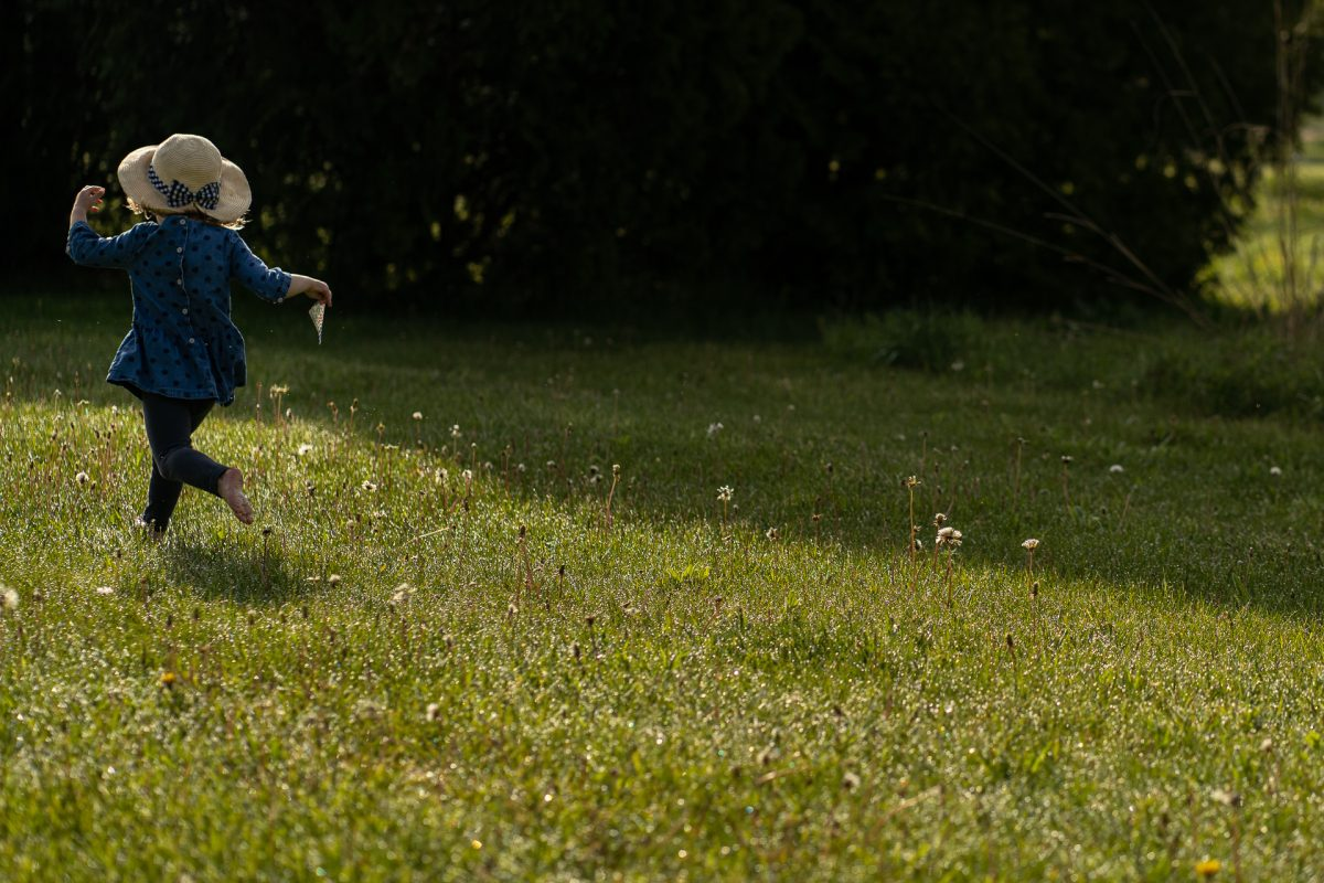 little girl running in the fields cottage grove wi