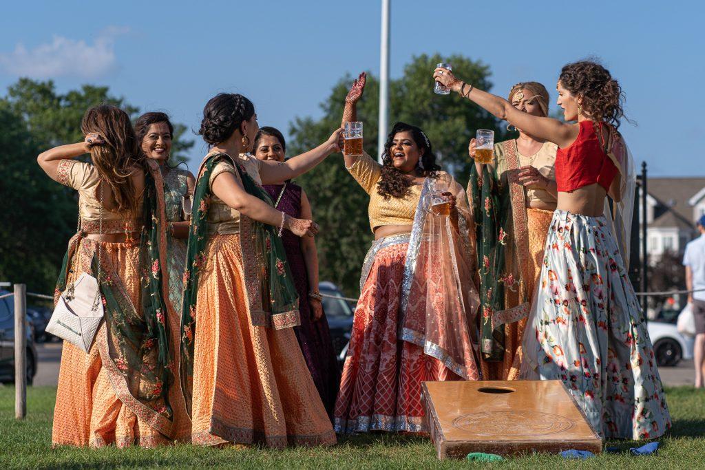 bride and bridesmaids cheering bean bag toss