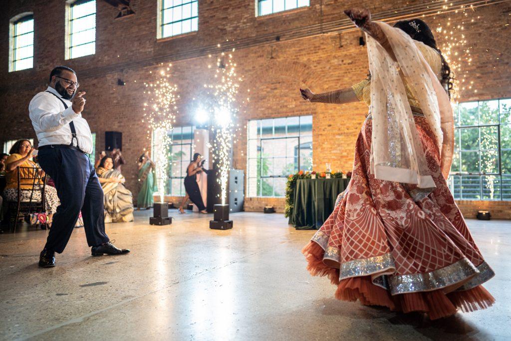 bride and groom indian dance wedding reception