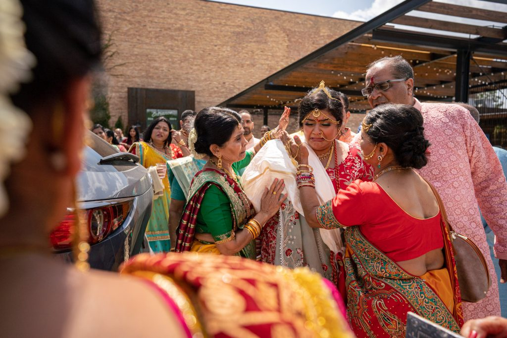 bride and her family crying during send off