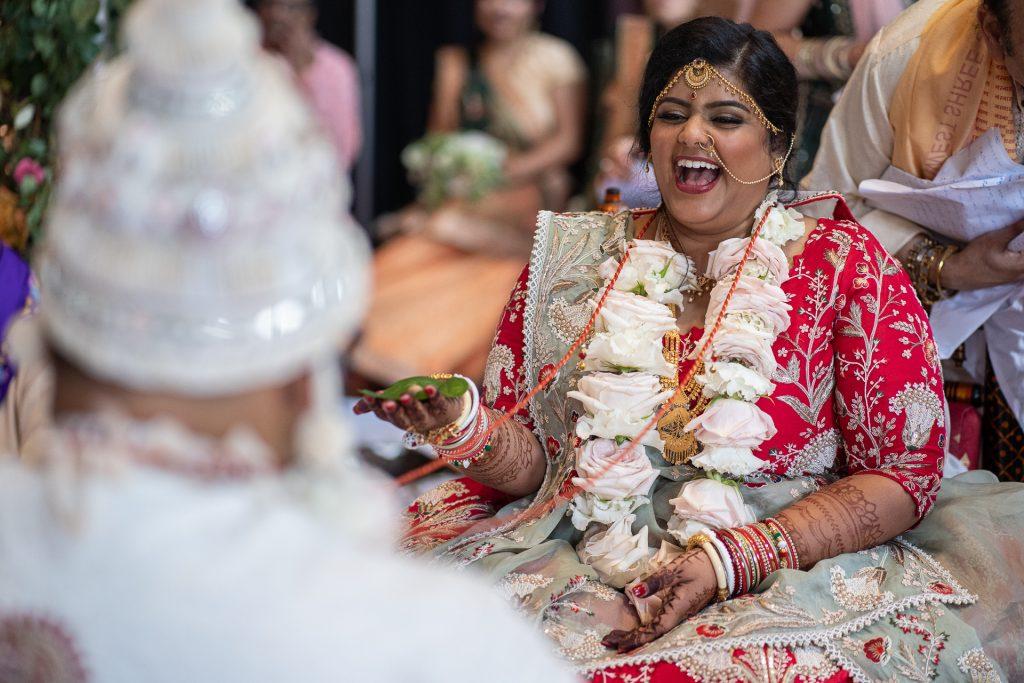 bride laughing hindu wedding ceremony