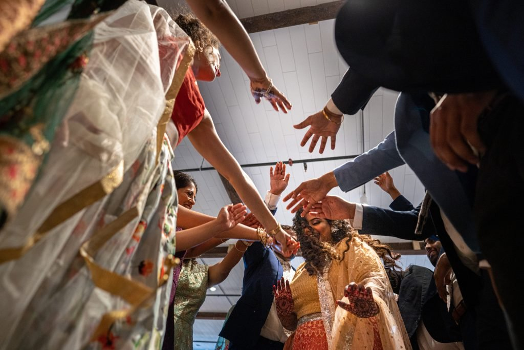 bride surrounded by hands dancing