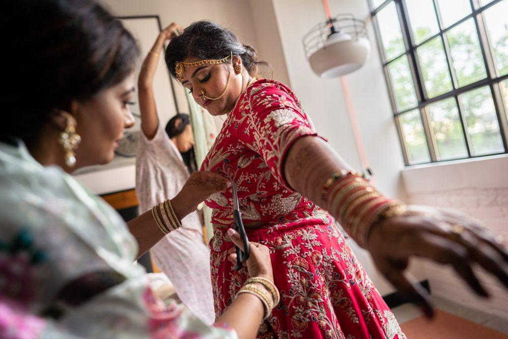 bridesmaid helping indian bride madison wi