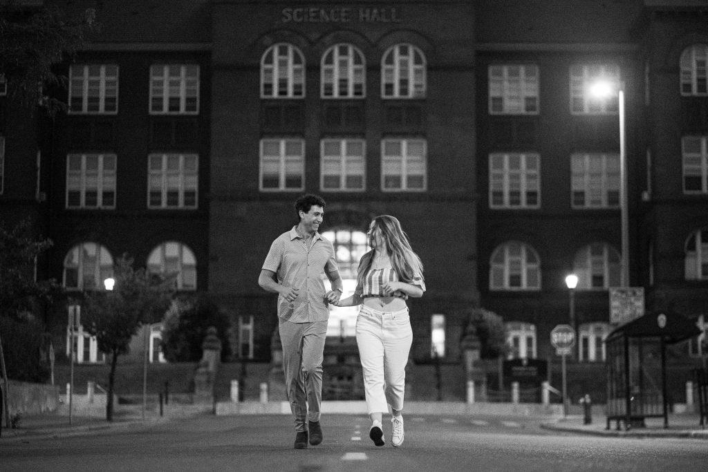 couple running on street madison wi