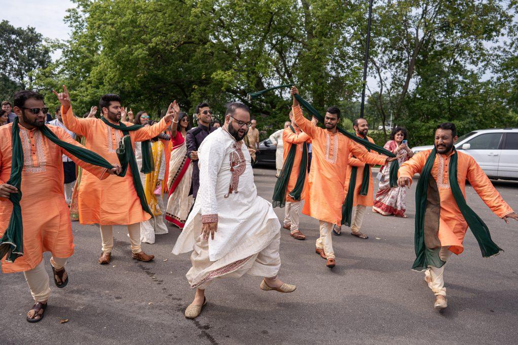 groom and groomsmen dancing baraat