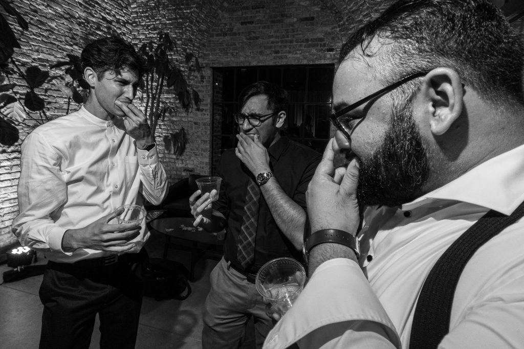groom and guests drinking a shoot
