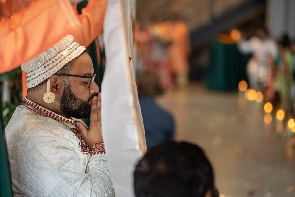 groom behind veil waiting for bride garver feed mill