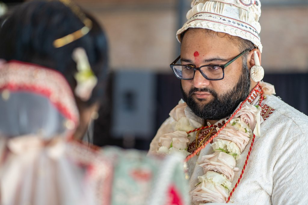 groom staring at bride with teary eyes