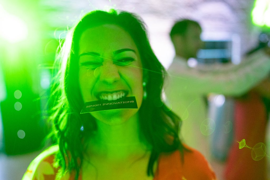 guest with business card on her mouth
