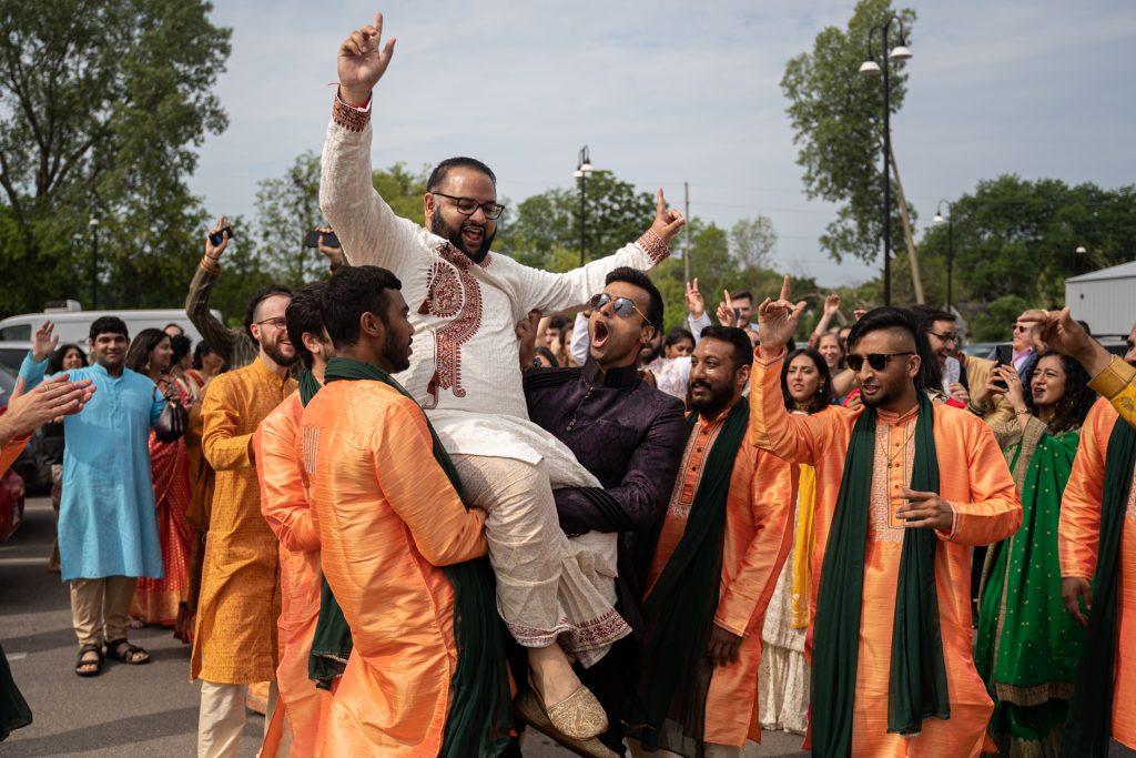 guests lifting groom baraat madison wi