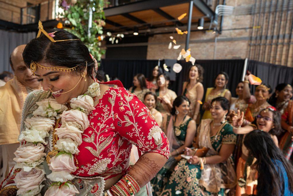 guests throwing petals at bride