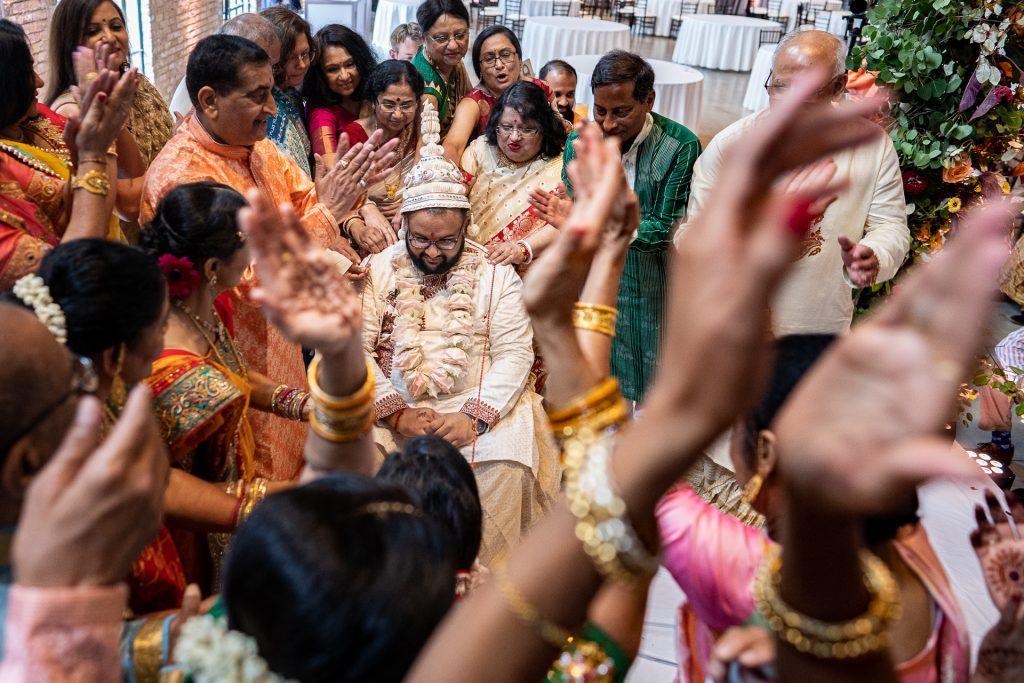 hindu wedding ceremony families holding line