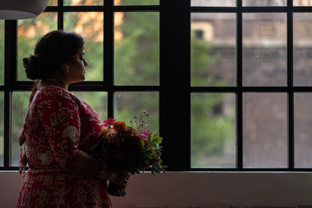 indian bride by indigo hotel room window