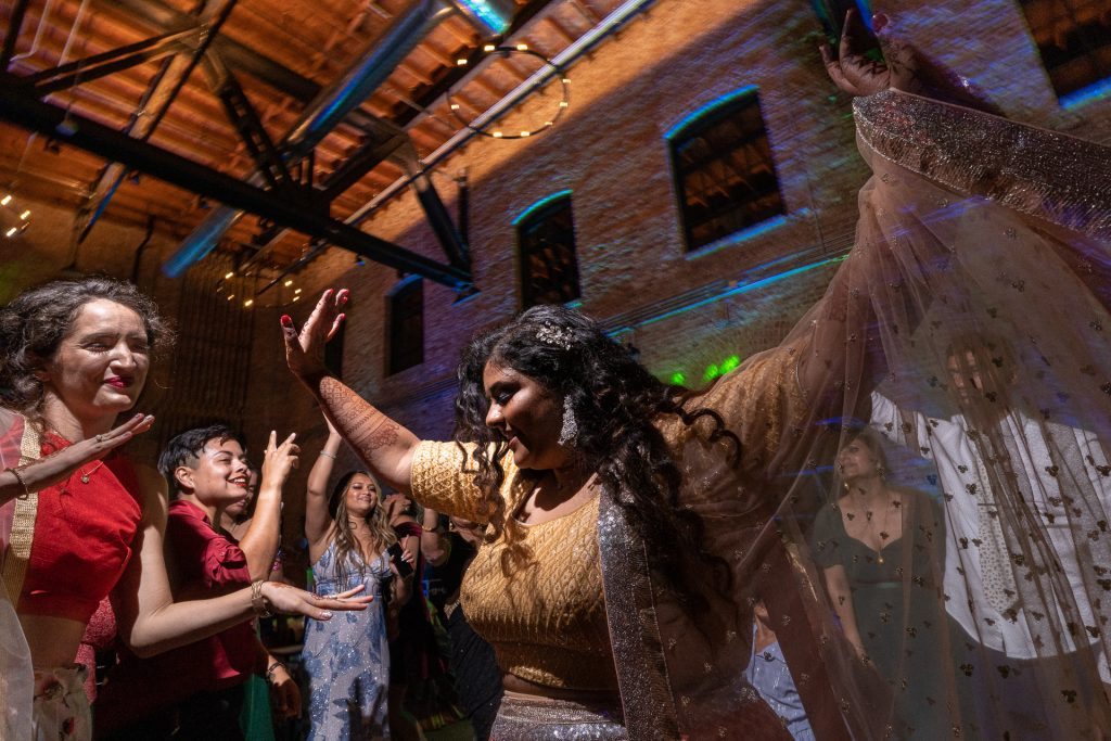 indian bride dancing with guests