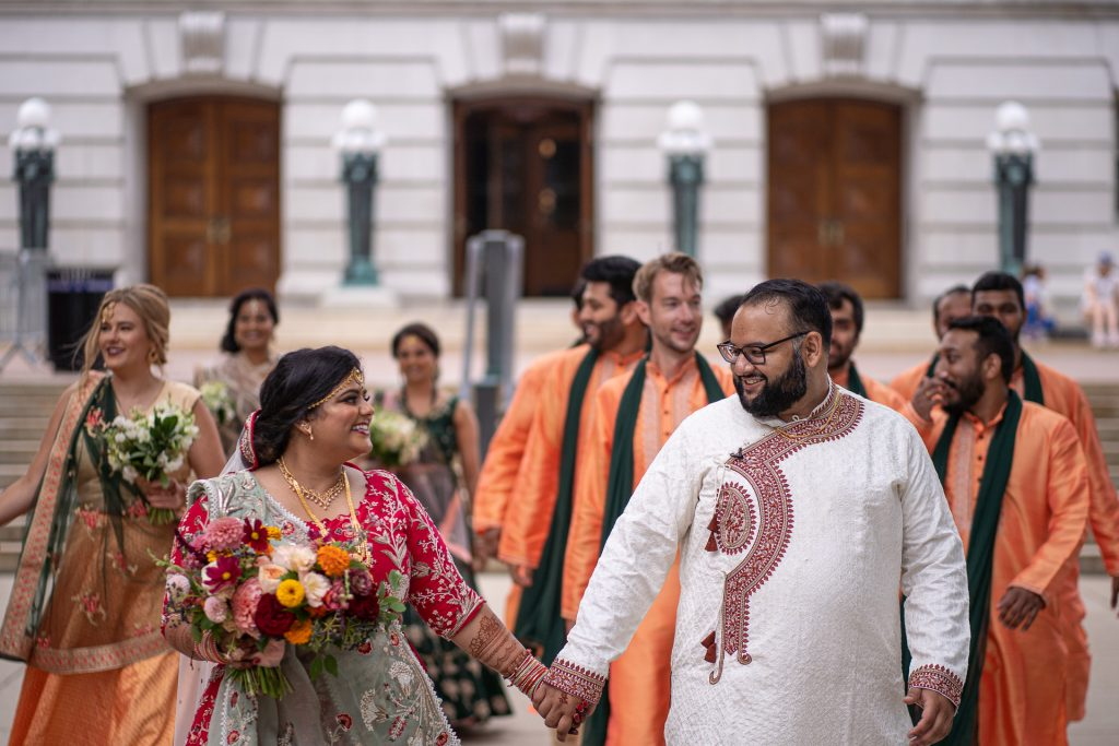 indian couple and wedding party by the wisconsin capitol steps